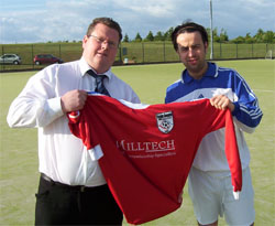 Watson and Gourlay with the new shirt, striking a pose for the sponsor, Milltech.