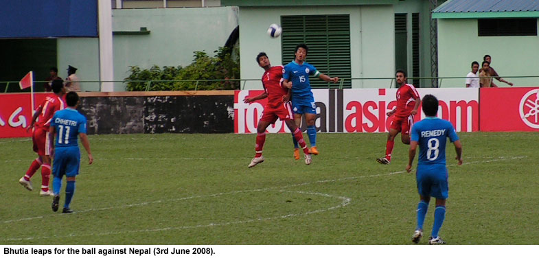 Bhutia challenges for the ball.