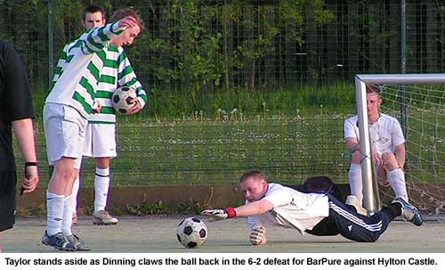 Craig Dinning claws at the ball as he makes another save, in vain, during BarPure's 6-2 defeat against Hylton Castle
