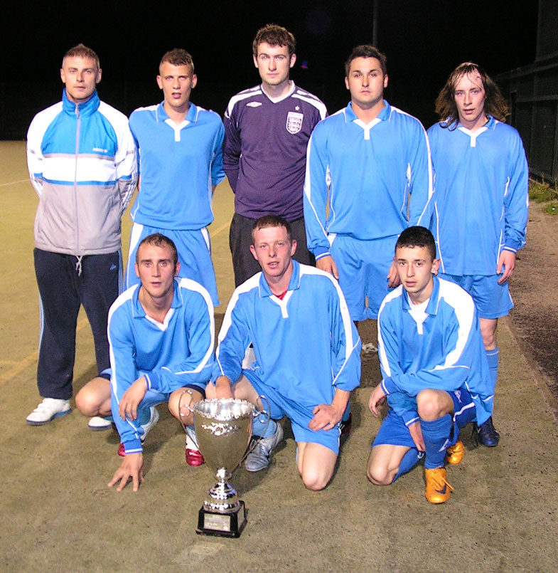 League Champions! A different looking Hylton Castle team pictured with the trophy after their 3-1 League and Cup win over Downhill FC. Manager, Danny Hodgson (sitting centre, behind the trophy) can finally say his investment in the team over these past few years has brought success. Hylton Castle are now Champions on Tuesday's and Thursday's.