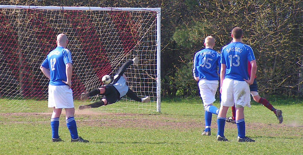 Davey Chops dives, but the penalty puts Usworth 2-1 ahead. Photo by Scott Hembrough.