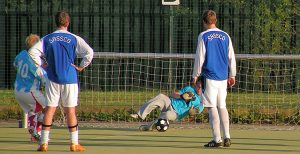 Gary Tyzack (number 10, watched by Lay and Lay in change shirts) fires in a penalty which is saved by Laing.