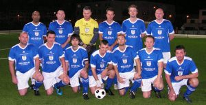 The team pictured prior to the first game.