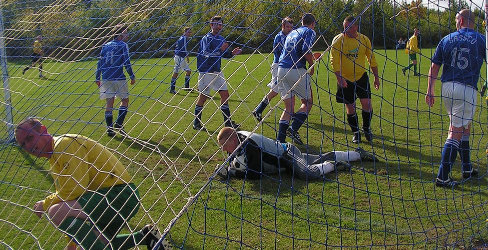 Simpson gathers the ball in the first half after a clearance off the line from Gourlay.