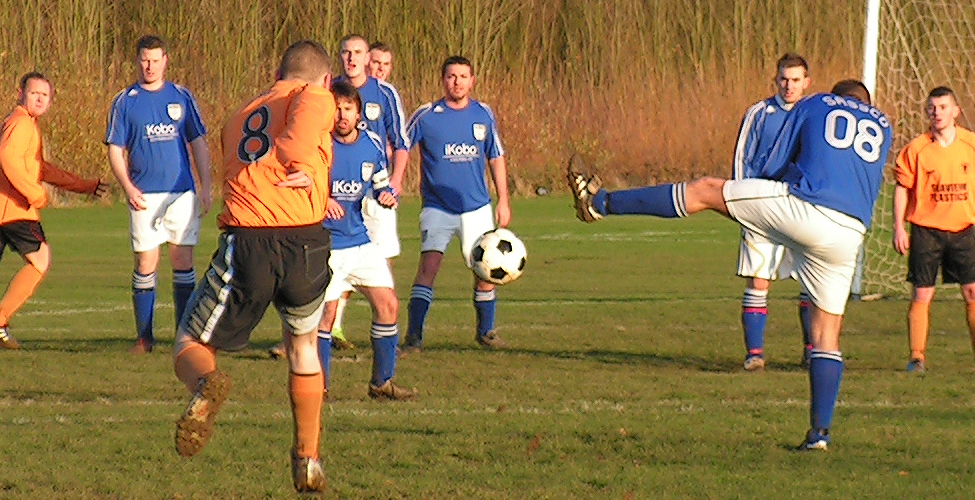 A free-kick from The Cove is defended against, with Michael Pearson sacrificing his testicles for Sassco (again).