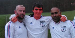 Simon (Osama) Mulvaney (First Aid), Wayne Greenwell (Team Coach, looking a bit off colour as he'd been blasted in his only testicle ten minutes before) and Davinder Sangha (General Manager).
