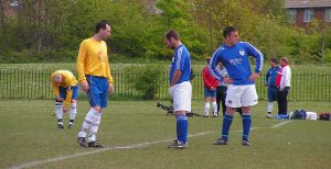 Neil Middlemiss and Scott Hembrough compare tackle sizes before the game while Callum Howe turns away.
