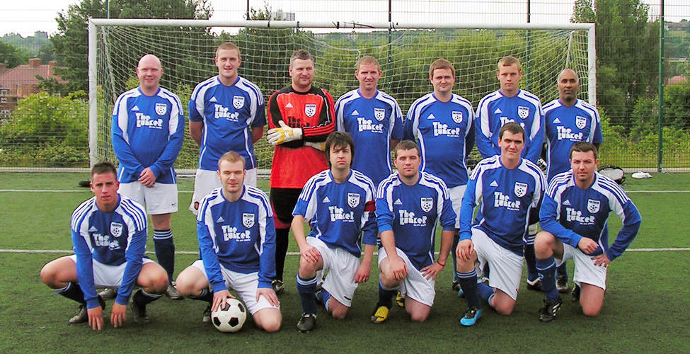 The team pictured in the new shirts.