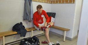 Dixon holds up his high line in the changing rooms.