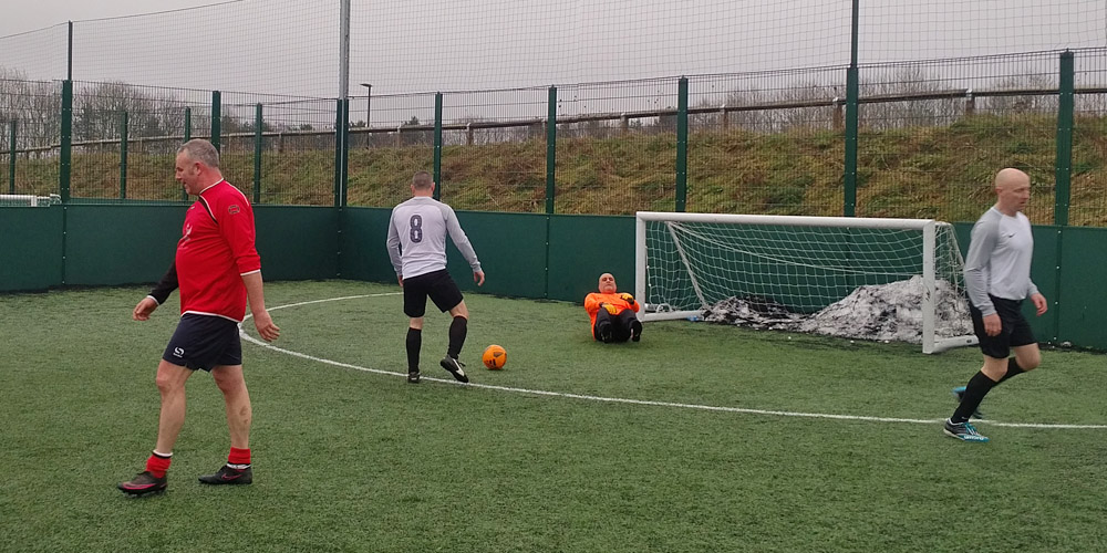 Fatty Wardle walks away after scoring past Sporting Redhouse. Sangha in goal, with Kelsey and Wilson in picture.