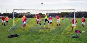 A technicolour goalmouth scramble with an Adidas Tango ball.